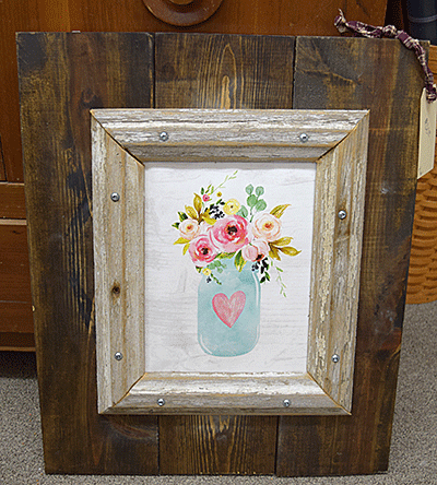 Flower painting on a woodboard frame